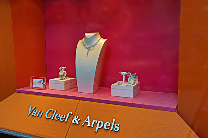Custom-designed retail window display case for Van Cleef & Arpels
