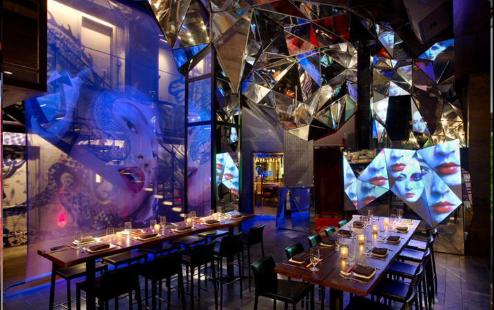 Custom-designed restaurant interior with video mapping surfaces throughout.