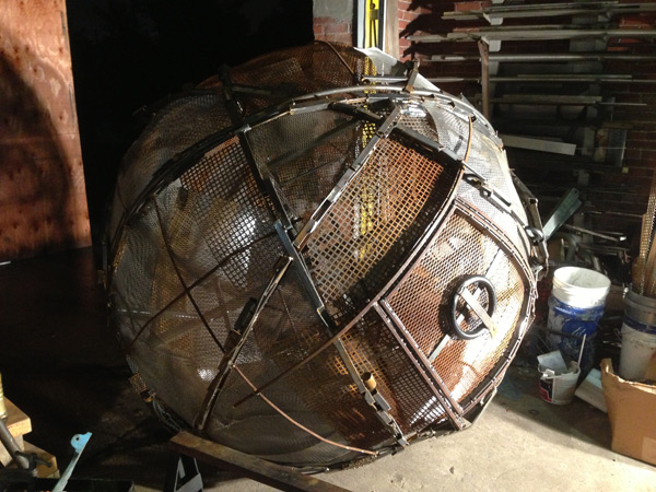 Upcycled steel sphere performance art piece.
